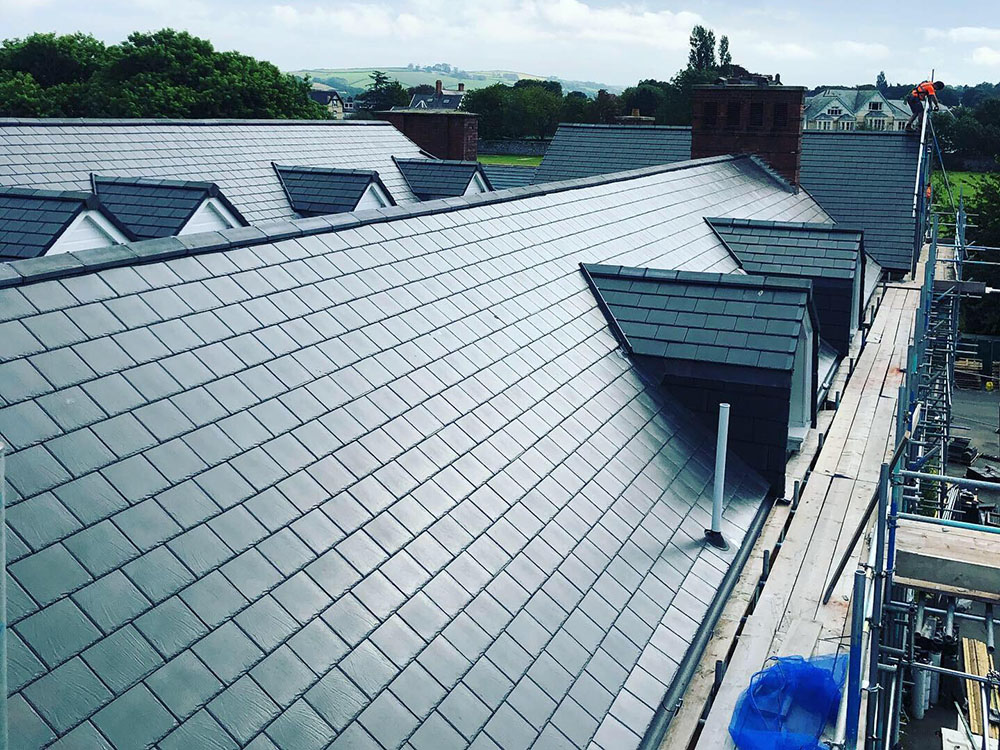 Medium-scale (1,500m²) refurbishment of the pitched and flat roofs at a secondary school in Barnstaple, Devon